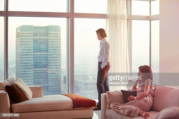 Business couple relaxing in city apartment