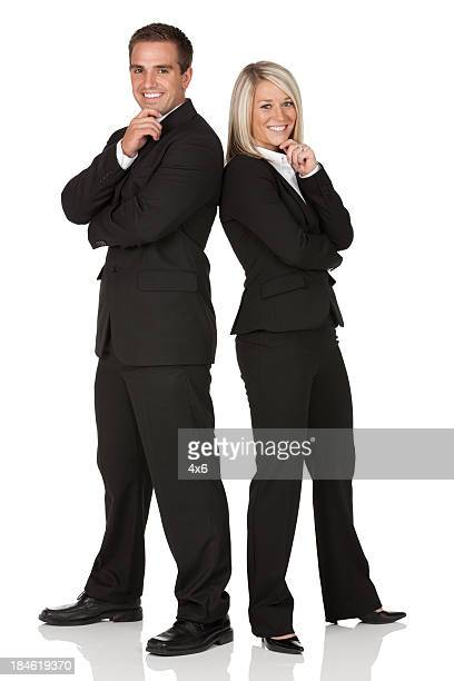 Business couple smiling