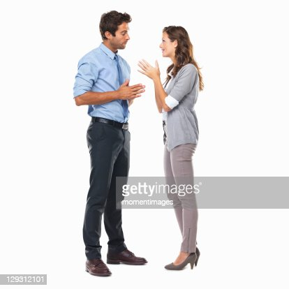 Business couple standing and having discussion