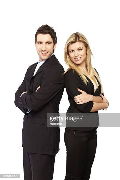 Business couple standing with crossed arms