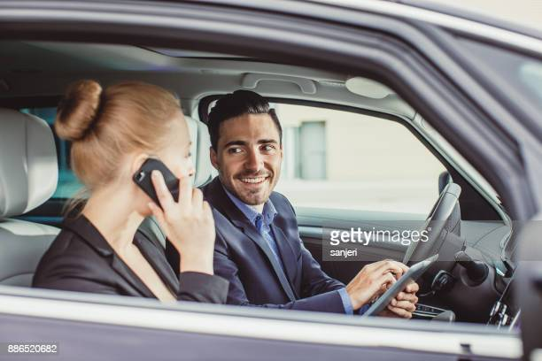 Business Couple Talking in the Car