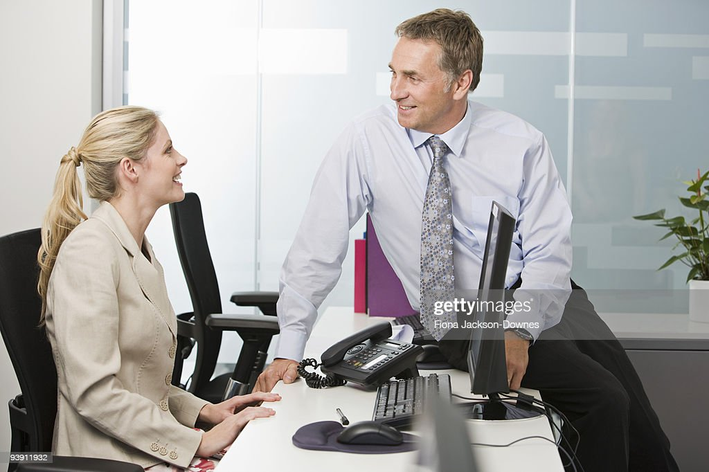 A business couple talking : Stock Photo