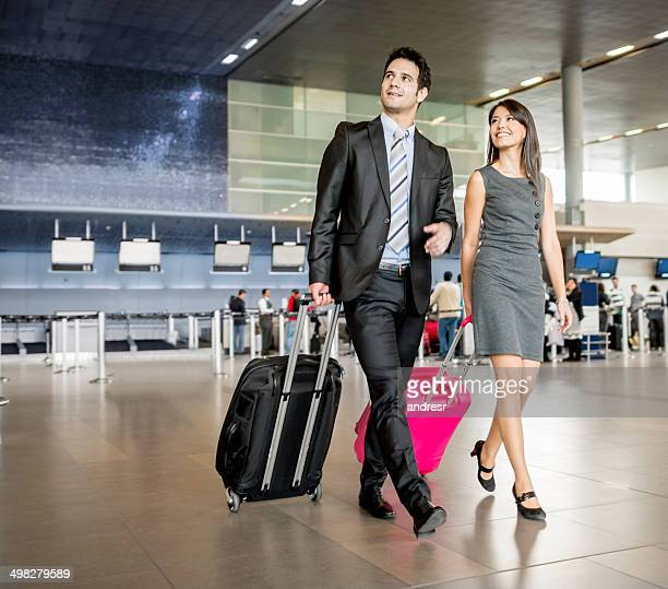 Business couple traveling