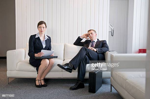 A business couple waiting in reception