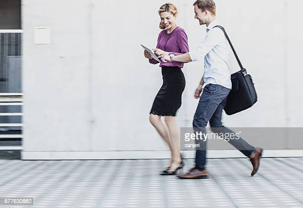 Business Couple Walking Through the Financial District