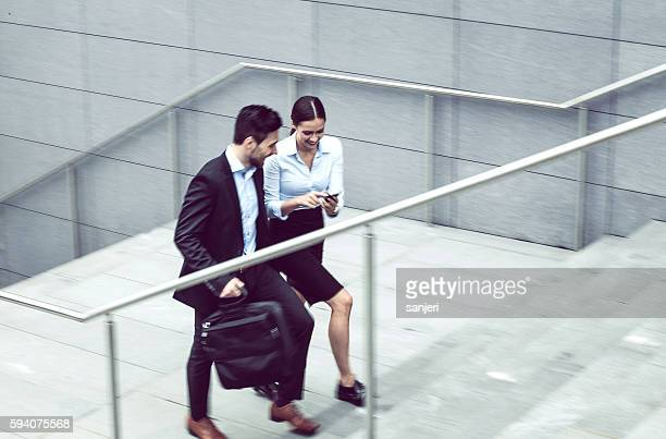 Business Couple Walking up the Stairs