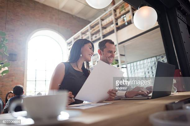 Business couple working at a restaurant