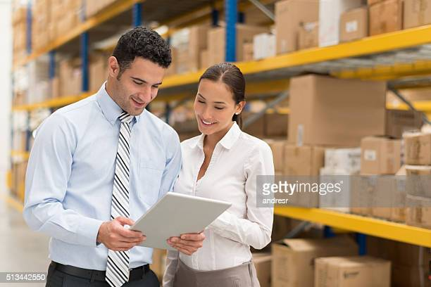 Business couple working at a warehouse