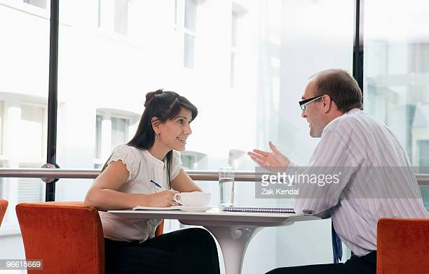 Business couple working in restaurant