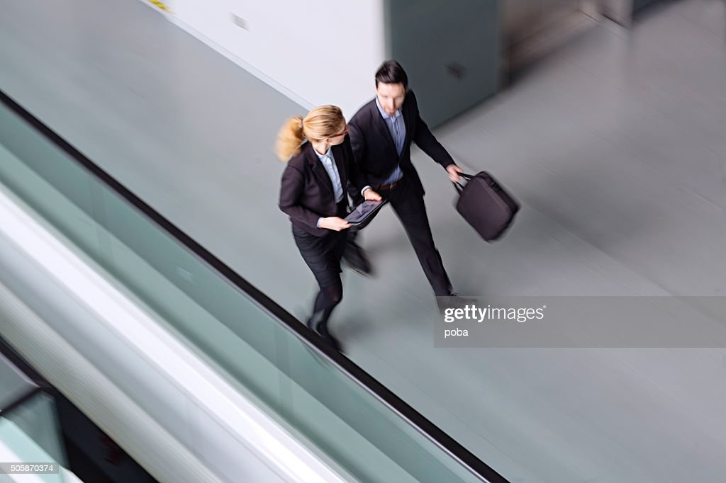 Business coworkers  walking together in office building : Stock Photo