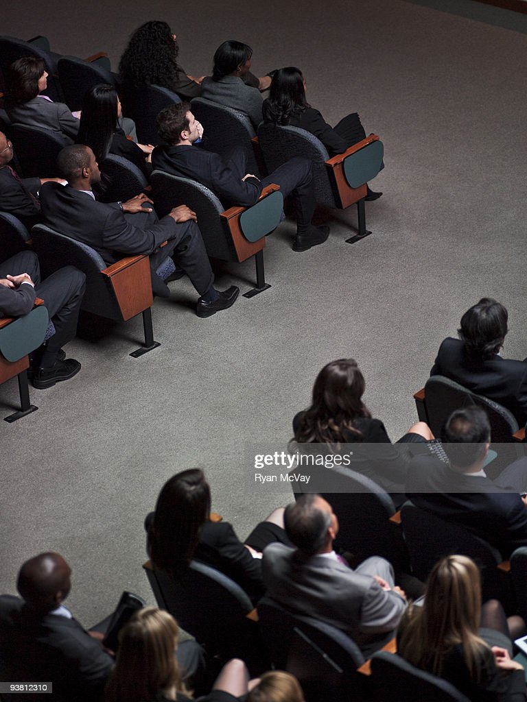 Business crowd in auditorium
