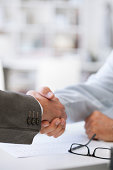 Business deal closed with handshake