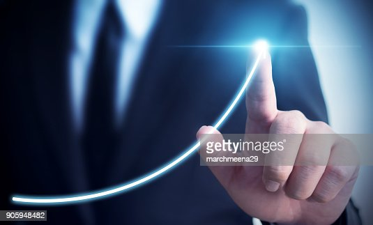 Business development to success and growing annual revenue growth concept, Businessman pointing arrow graph corporate future growth plan : Stock Photo