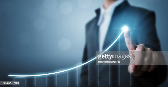 Business development to success and growing growth concept, Businessman pointing arrow graph corporate future growth plan : Stock Photo