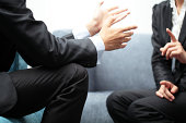 Hand gesture of a businesswoman and businessman in meeting.