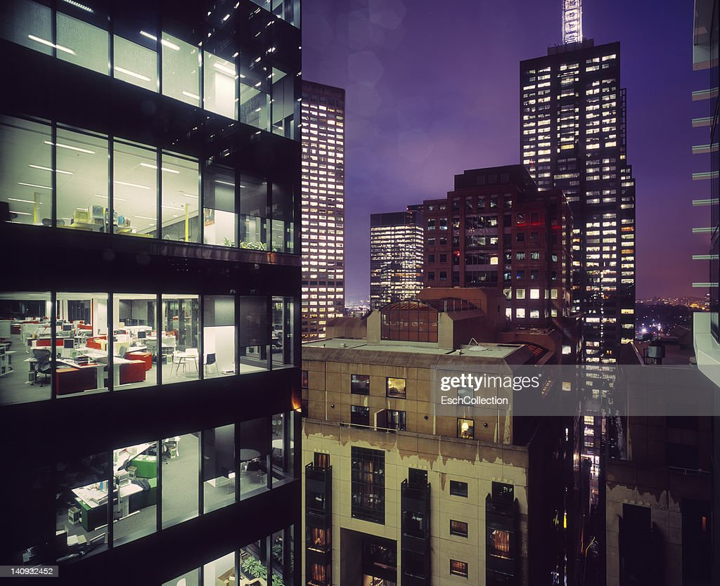 Business district with illuminated offices : Stock Photo