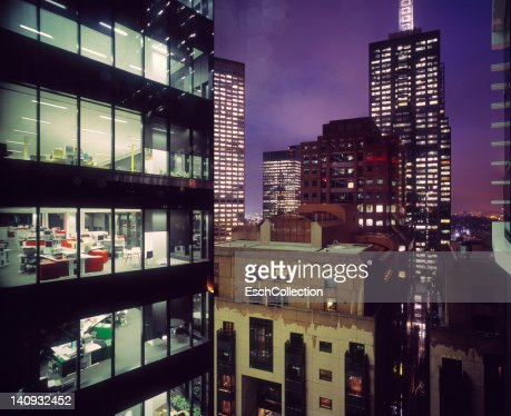 Business district with illuminated offices : Bildbanksbilder