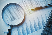 business documents accounting with calculator, pen and magnifying glass. concept for financial
