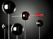 One red arrow piercing a ball shaped target mouted on a pole, black background, Blur effect3D render illustration