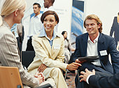 Business executive discussing at exhibition