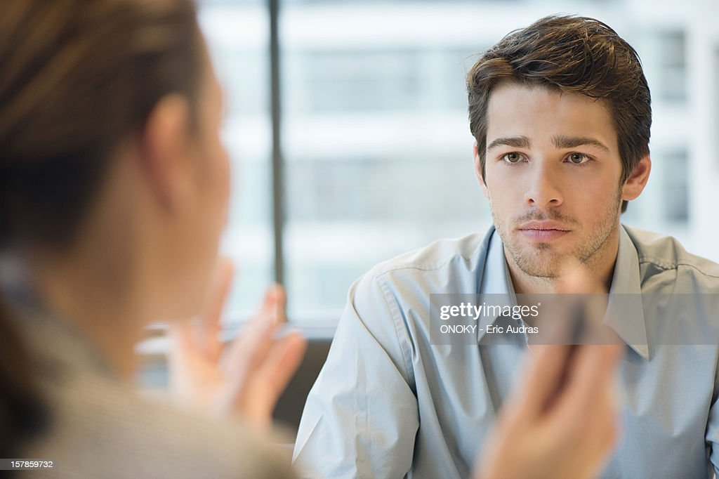 Business executive discussing with her client : Stock Photo