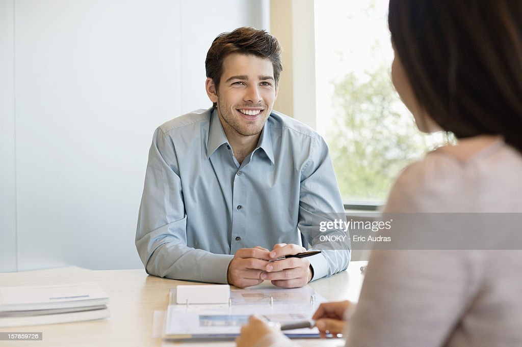 Business executive discussing with his client : Stock Photo