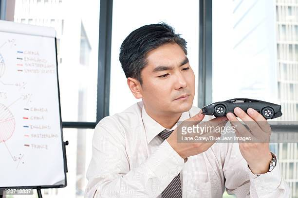 Business Executive Examining Product Model