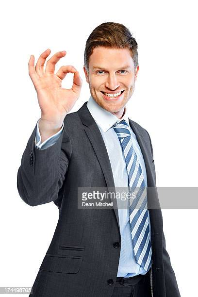 Business executive gesturing an excellent job
