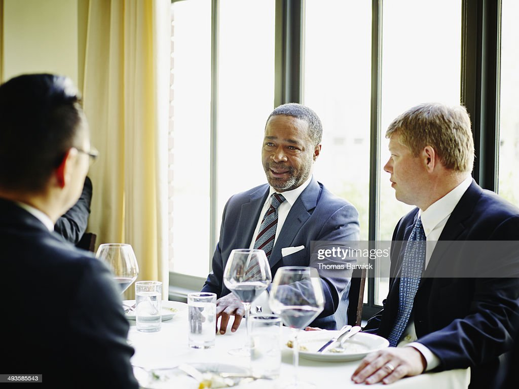 Business executive leading lunch meeting : Stock Photo