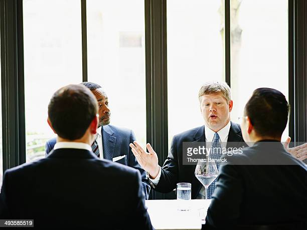 Business executive leading meeting in restaurant