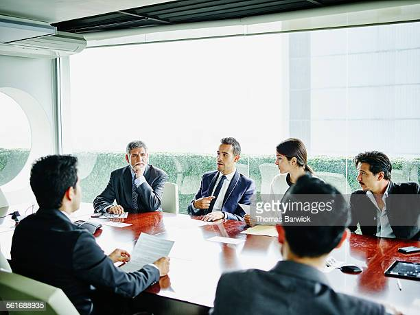 Business executive leading team meeting