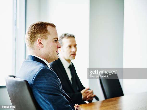 Business executive listening during meeting