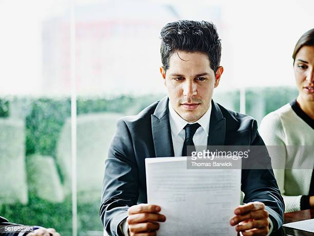 Business executive reviewing documents
