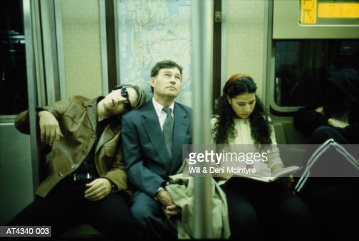 Business executive riding subway train, New York City, USA : Stock Photo