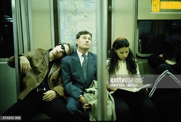 Business executive riding subway train, New York City, USA