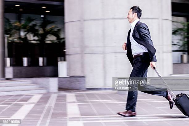Business executive running to catch his next meeting.