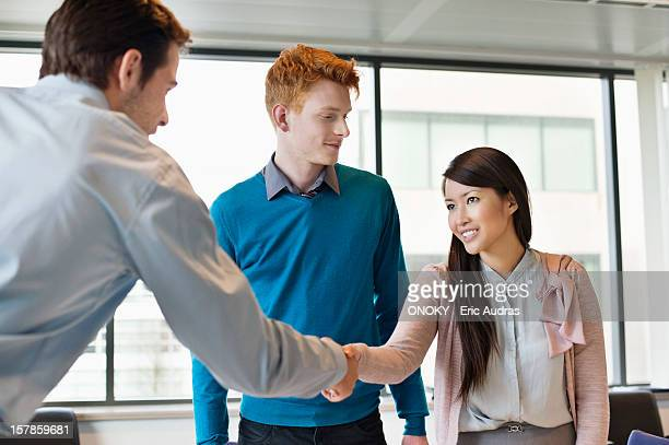 Business executive shaking hands with his clients
