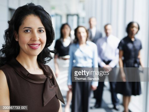 Business executive smiling colleagues in background, portrait : Stock Photo