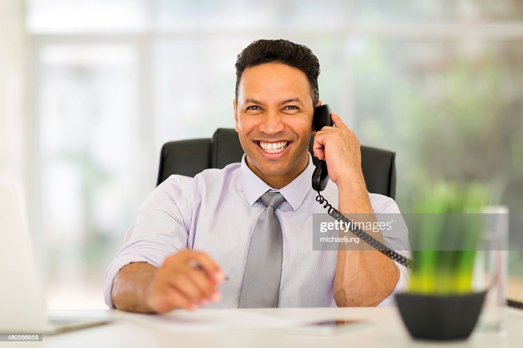 business executive talking on landline : Stock Photo