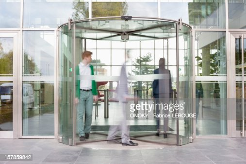 Business executives at entrance of an office building