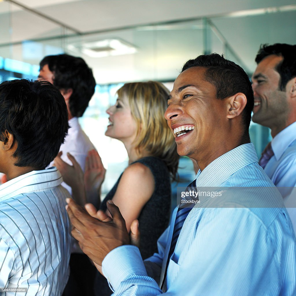 business executives clapping and cheering
