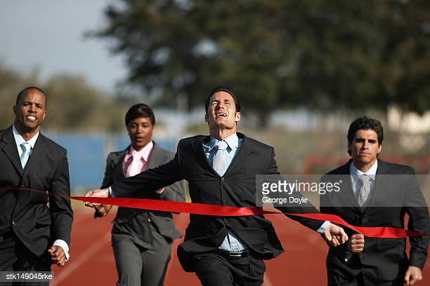 business executives crossing the finish line