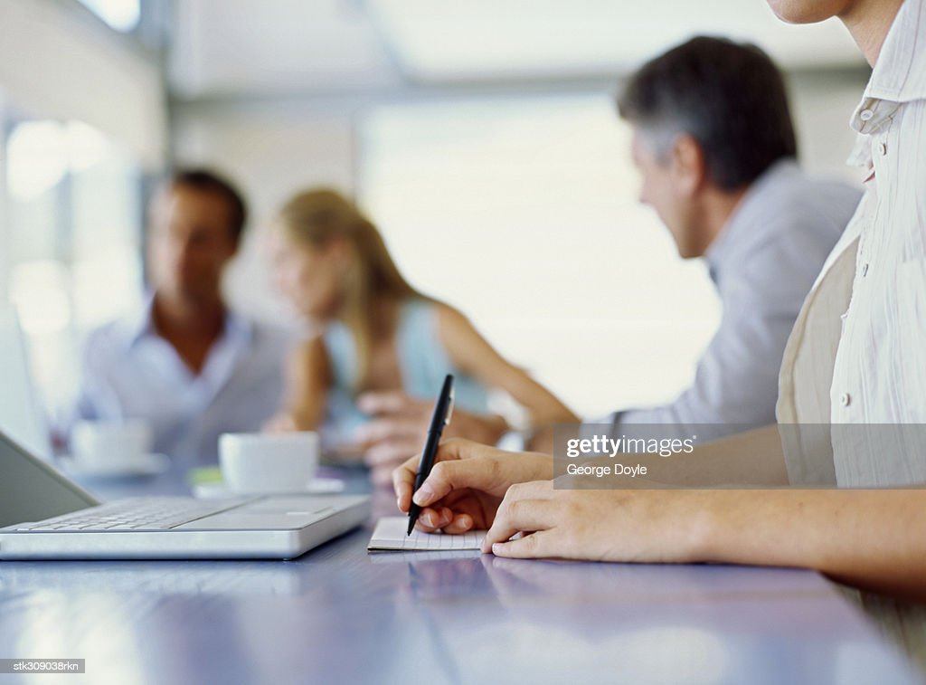 business executives discussing work in an office : Stock Photo