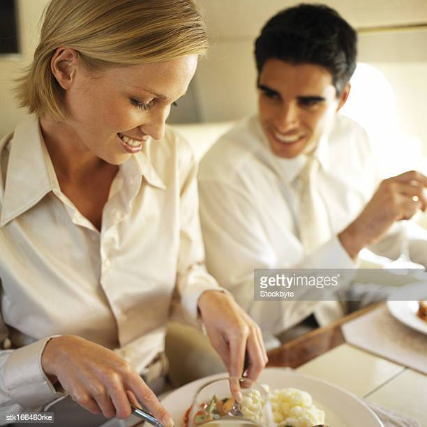 business executives eating and drinking in an airplane