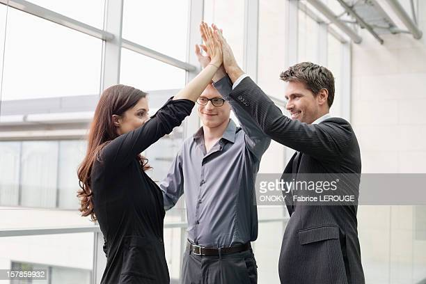 Business executives giving high-five to each other