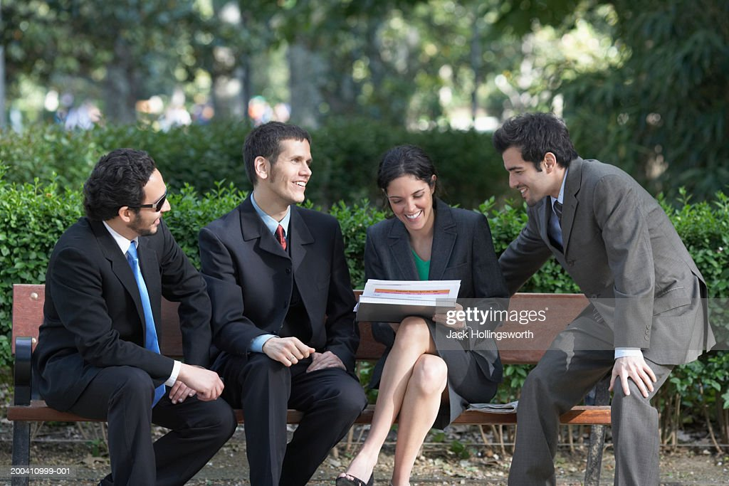 Business executives having a meeting on a park bench : Stock Photo