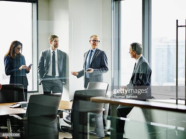 Business executives in discussion after meeting