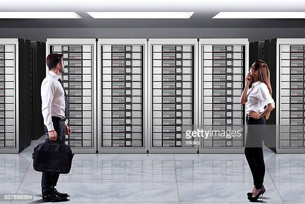Business executives looking at server