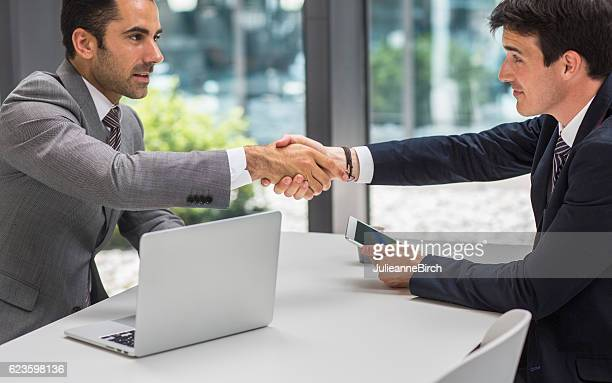Business executives shaking hands on a deal