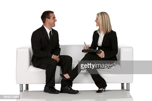 Business executives sitting on couch